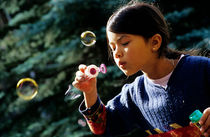 Girl blowing bubble-wand by Sami Sarkis Photography