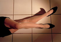 Woman lying on floor by Sami Sarkis Photography