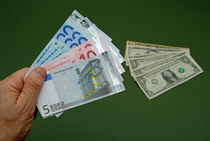 Man holding Euro banknotes by Sami Sarkis Photography