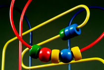 Colourful toy abacus with bright beads. von Sami Sarkis Photography