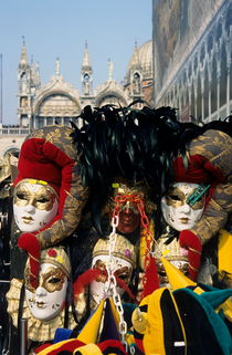 Person surrounded by elaborate masks for sale on St Mark's Basilica by Sami Sarkis Photography