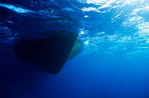 Hull of a boat is seen from underwater Soraya Reef by Sami Sarkis Photography