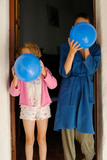 Children blowing up balloons by Sami Sarkis Photography