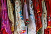 Row of hanged traditionnal vietnamese clothes von Sami Sarkis Photography