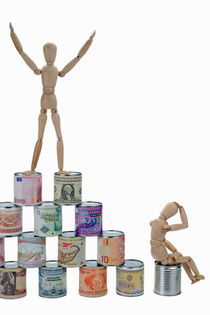 Mannequins on a banknotes pyramid by Sami Sarkis Photography