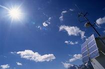 Solar panels and sun by Sami Sarkis Photography