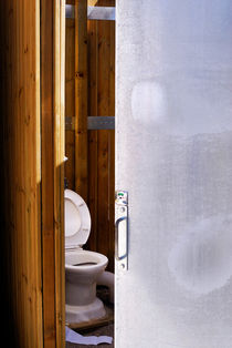 Toilet in public restroom by Sami Sarkis Photography