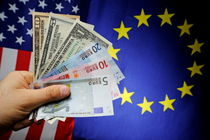 Man's hand with US and Euro banknotes on European Union and US Flag von Sami Sarkis Photography