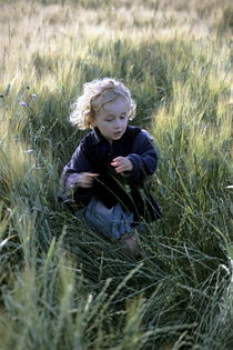Girl running in wheat field by Sami Sarkis Photography