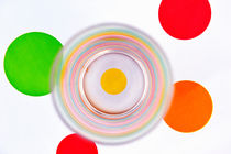 Empty Glass on tablecloth with multi-colored spots  by Sami Sarkis Photography