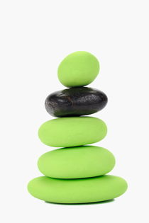 Stack of green and black pebbles by Sami Sarkis Photography