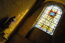 Virgin statue and stained window in a church von Sami Sarkis Photography