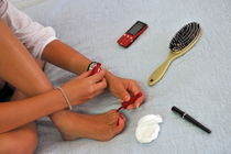 Girl painting her toe nails by Sami Sarkis Photography