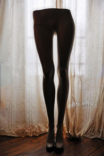 Mannequin legs standing by window von Sami Sarkis Photography