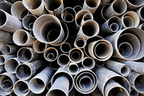 Stacked PVC tubes at shop by Sami Sarkis Photography