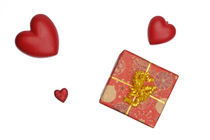 Gift box and heart-shaped objects on white background by Sami Sarkis Photography