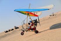 Microlite plane landing in desert by Sami Sarkis Photography