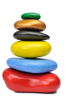 Stack of multi-colored pebbles by Sami Sarkis Photography