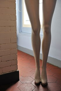Mannequin legs standing by window by Sami Sarkis Photography