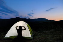 Silhouette of teenager girl (13-14) in illuminated tent by Sami Sarkis Photography