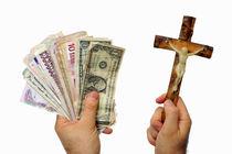Man's hand with international banknotes and crucifix von Sami Sarkis Photography