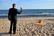 Businessman on beach with Landline Phone receiver von Sami Sarkis Photography