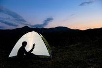 Silhouette of woman in illuminated tent von Sami Sarkis Photography