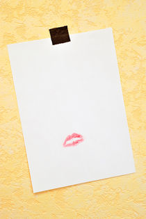 White paper hanged on wall with lipstick kiss by Sami Sarkis Photography
