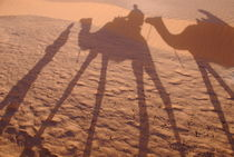 Men and camels shadows on sand dune by Sami Sarkis Photography