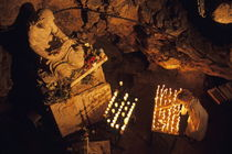 Woman burning candle at Troglodyte Sainte-Marie Madeleine Holy Cave von Sami Sarkis Photography