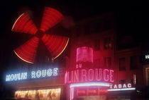 Illuminated neon signs of the Moulin Rouge by Sami Sarkis Photography