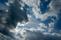 Clouds and sunlight in the sky following a storm by Sami Sarkis Photography