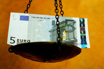 Scale weighing a five Euro banknote. by Sami Sarkis Photography