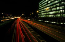 Traffic on a city highway at night near La Défense business district by Sami Sarkis Photography