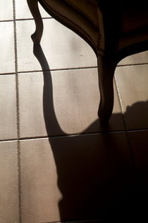 Shadow of an armchair on a tiled floor. von Sami Sarkis Photography