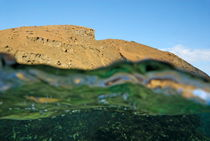 Bartolome Island rock and water surface (split shot half underwater) by Sami Sarkis Photography