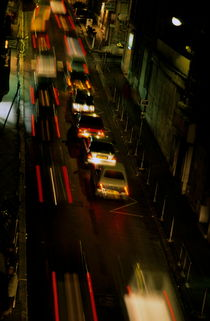 Cars travelling along a street during a rainy night. by Sami Sarkis Photography
