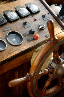 Controls and steering wheel of a dive boat. by Sami Sarkis Photography