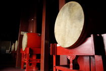 Drums lined up in a row inside a drum tower by Sami Sarkis Photography