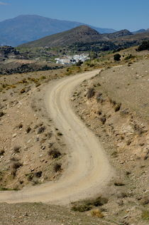 Dirt road winding above Capileira village in the Alpujarras mountains von Sami Sarkis Photography