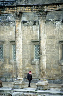 Man walking between columns at the Roman Theatre by Sami Sarkis Photography