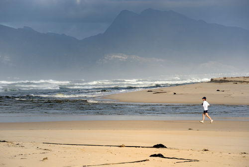 Woman-running-jogging-beach-alrm-saa-fna6747