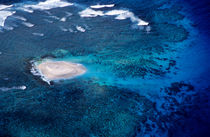 Sandy island surrounded by tropical seas in the Pacific Ocean. by Sami Sarkis Photography