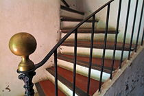 Wrought iron handrail of an old staircase. by Sami Sarkis Photography