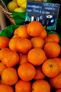 Oranges displayed in a grocery shop by Sami Sarkis Photography