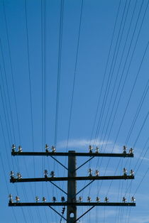 Electrical pylon and wires in Cuba. by Sami Sarkis Photography
