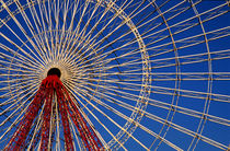 Ferris wheel in an amusement park on a sunny day. by Sami Sarkis Photography