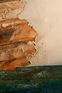 Paint peeling from a boat hull. by Sami Sarkis Photography