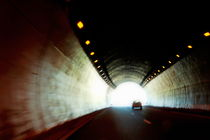 Car travelling inside a highway tunnel by Sami Sarkis Photography
