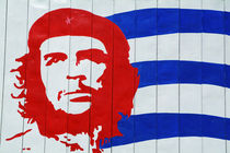 Billboard with the iconic Che Guevara portrait and national Cuban flag by Sami Sarkis Photography